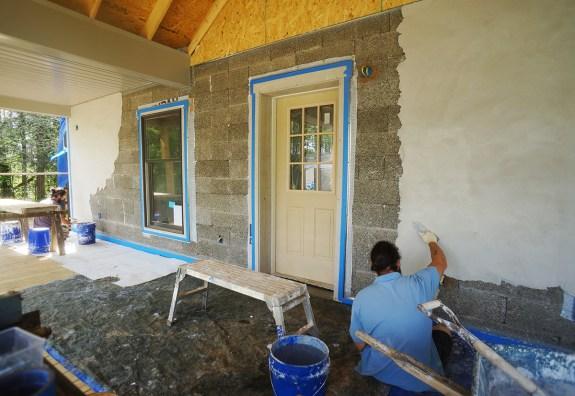 Lime plaster base coat on Faswall block