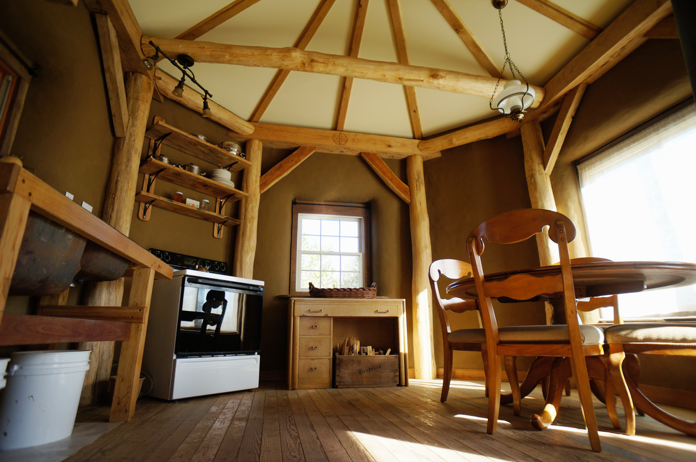 Timber frame straw bale house for sale natural home for Timber frame home interiors