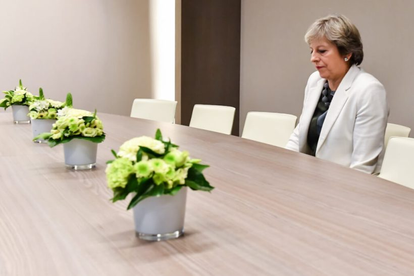 TOPSHOT - British Prime Minister Theresa May takes a seat as she arrives for a bilateral meeting with European Council President Donald Tusk during an EU summit in Brussels on October 20, 2017.   The EU is expected to say that they will start internal preparatory work on a post-Brexit transition period and a future trade deal with Britain. / AFP PHOTO / POOL / Geert Vanden Wijngaert        (Photo credit should read GEERT VANDEN WIJNGAERT/AFP/Getty Images)
