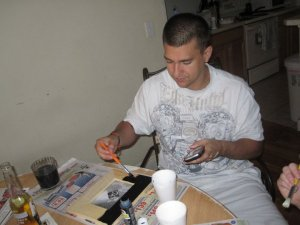 husband painting new picture frame for thismomhere