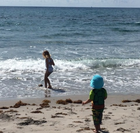 both kids playing at the beach