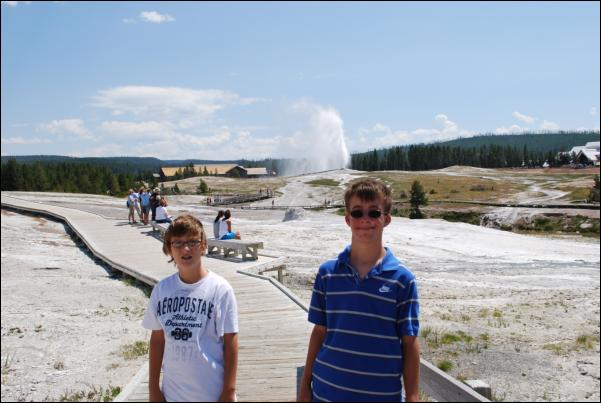 Grant and Bradley in front of Old Faithful
