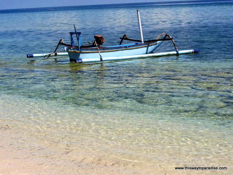 Boat in the waves of Gili Meno, Gili Islands