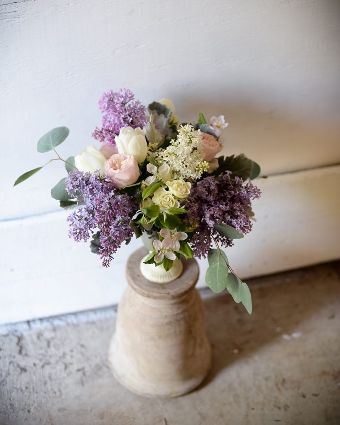 Flower arrangement featuring lilacs