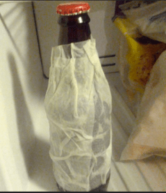 cover the bottle in a wet paper towel and place it in the freezer.