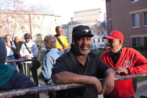 Homeless men waiting outside