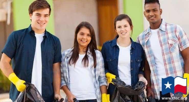 cheerful-teenage-volunteers-w-garbage-bags