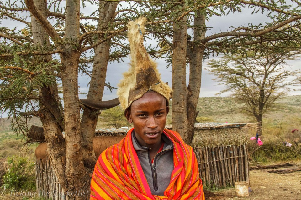 Maasai Warrior with headgear made using the mane of the lion that he hunted