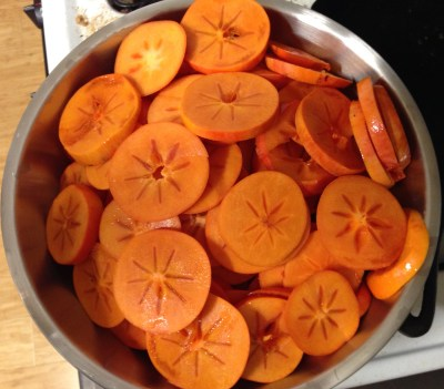 several pounds of persimmons, cut up for drying