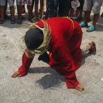 A magdarame falls on his knees during the traditional Good Friday procession in Pampanga on March 25.