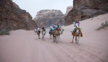 Tourists riding camels in Wadi Rum Desert Jordan