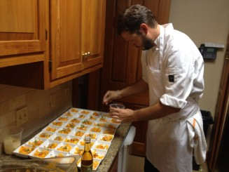 Jeremy from Village Cafe putting the finishing touches on his butternut squash and steen's vinegar slaw.