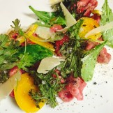 tomatoes greens and cured egg yolk