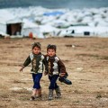 Syrian boys, whose family fled their home in Idlib, walk to their tent, at a camp for displaced Syrians, in the village of Atmeh, Syria. (Courtesy Freedom House)