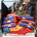 Carrying goods to earthquake victims.