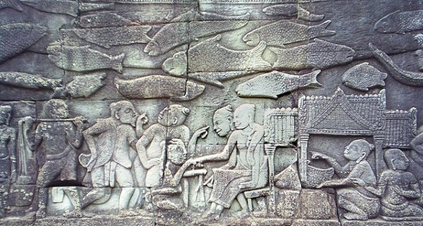 Carving in the southern gallery of Bayon temple depicting Chinese merchants buying from Khmer women