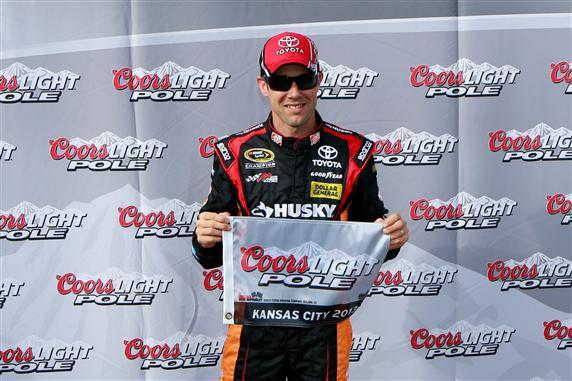 Credit: 285052Chris Trotman/Getty Images Matt Kenseth, driver of the #20 The Home Depot/Husky Toyota, poses with the Coors Light Pole award after qualifying for pole position for the NASCAR Sprint Cup Series STP 400 at Kansas Speedway on April 19, 2013 in Kansas City, Kansas.