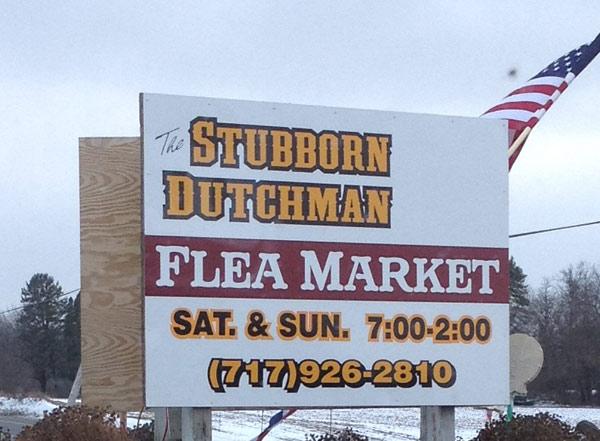 The Stubborn Dutchman Flea Market sign