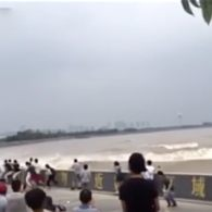 Thrillseekers Get Swept Up by Massive Incoming Tidal Bore in China: WATCH