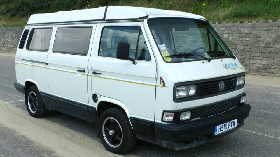 A classic camper van with accordion roof.