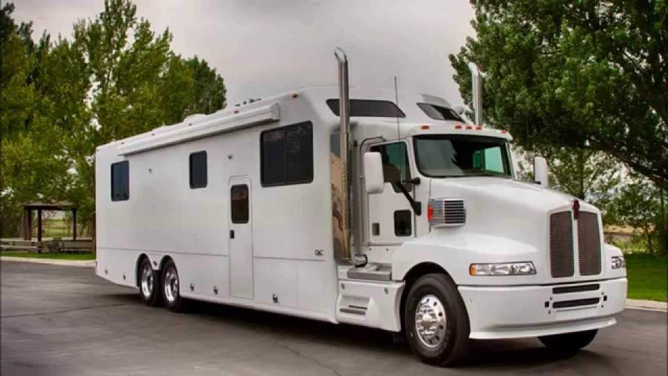 This is a custom motorhome built on a semi-truck chassis.