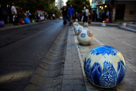 """We ate our first meal in Istanbul to the sound of tear gas being fired at protesters down the road. But a more peaceful side of the uprising there is that black railings, bollards, steps have everywhere been painted in colourful designs (and on the walls nearby, the graffiti reads, """"Police are murderers."""""""