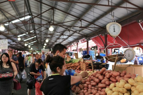 Victoria market is a chaotic combination of greengrocers, butchers, fishmongers and stalls selling cheap souvenirs