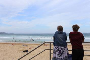 I saw this old couple staring silently out across the beach at Manly