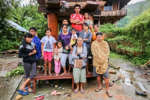 I spent the night sheltering from the rain in this family's haus tongkanan near Lorai