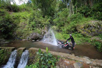 Stopping to wash Cornelius' bike