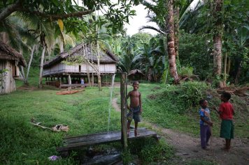A boy shows off in Wagu village, Sepik River