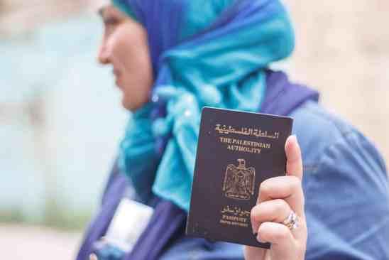 Photo of Woman Holding a Passport