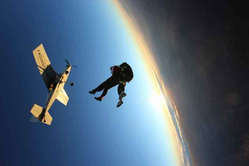 Photo of Author Jumping Out of Plane