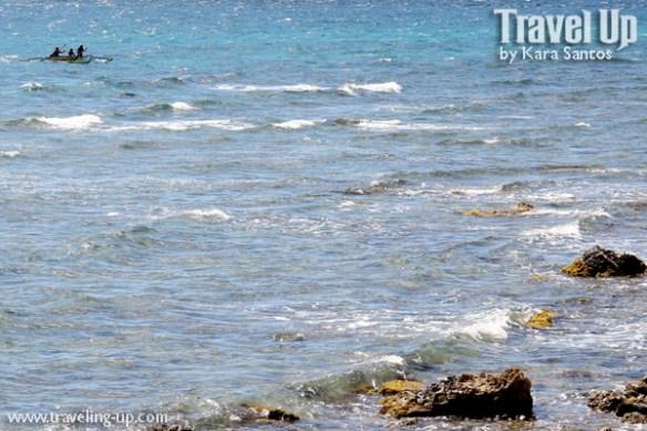 bohol by motorcycle ocean boat waves rocks