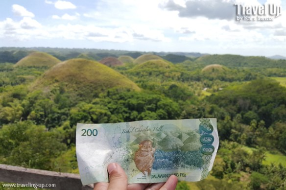 sidequest 200 peso bill with Bohol Chocolate Hills TravelUp