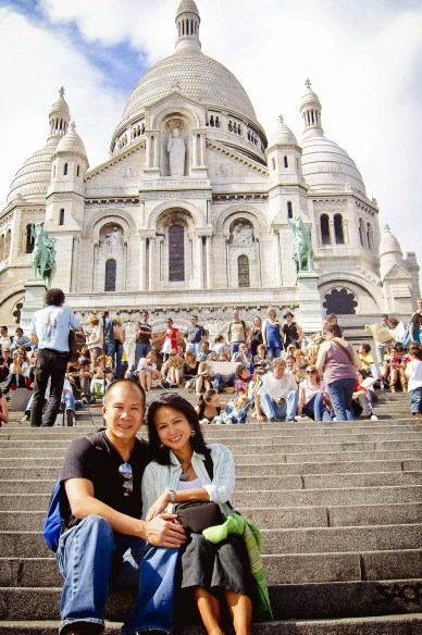 people sitting on steps of sacre couer