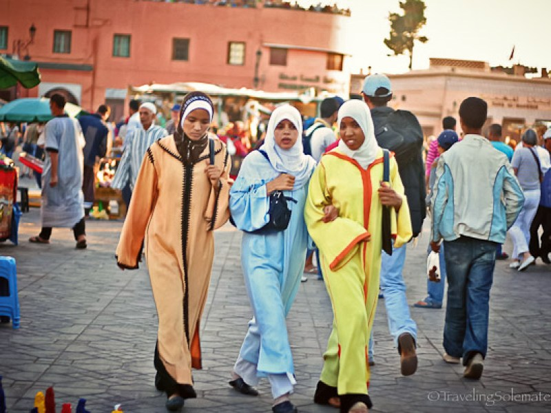 Woman walking in Djemaa el Fna Marrakesh