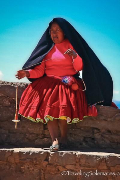 Woman knitting on on Taquile Island, Lake Titicaca, Peru