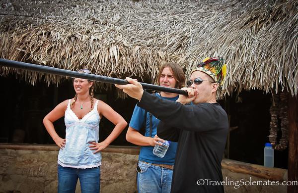 Blowing indigenous dart in Inti Nan Museum in Ecuador