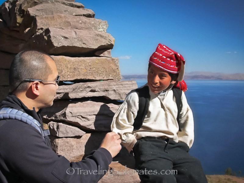 Talking to a boy on on Taquile Island, Lake Titicaca, Peru