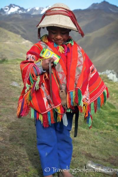 Boy with slingshot on Lares Valley Trek Peru