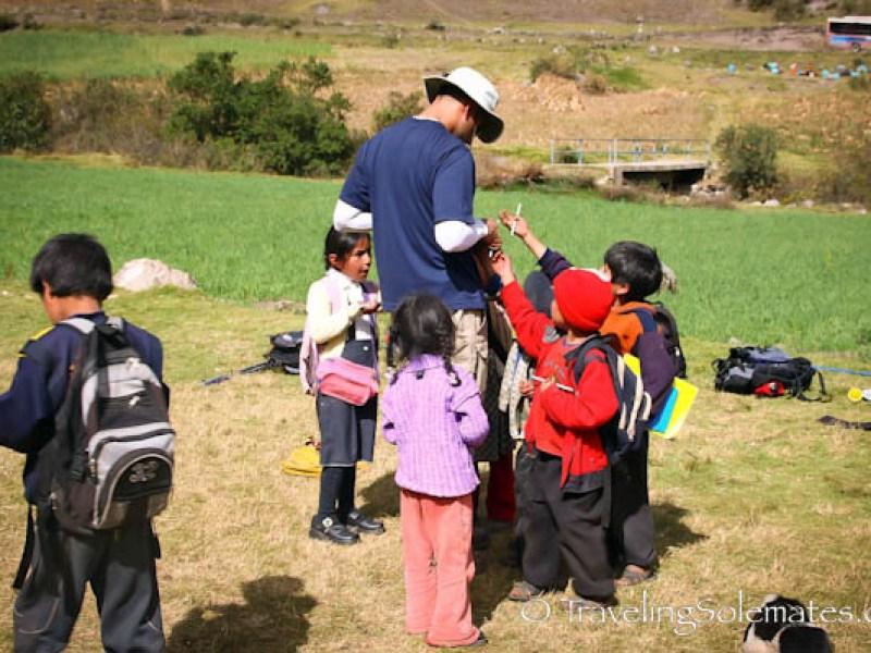 Trekker and studeents in Pitacancha schhol, Laresr Valley trek Peru