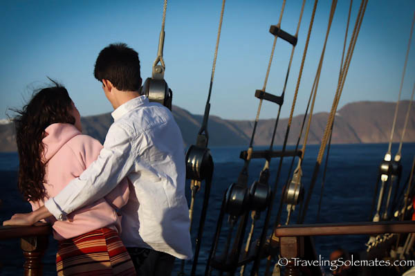 Lovers in Sailboat in Santorini, Greece