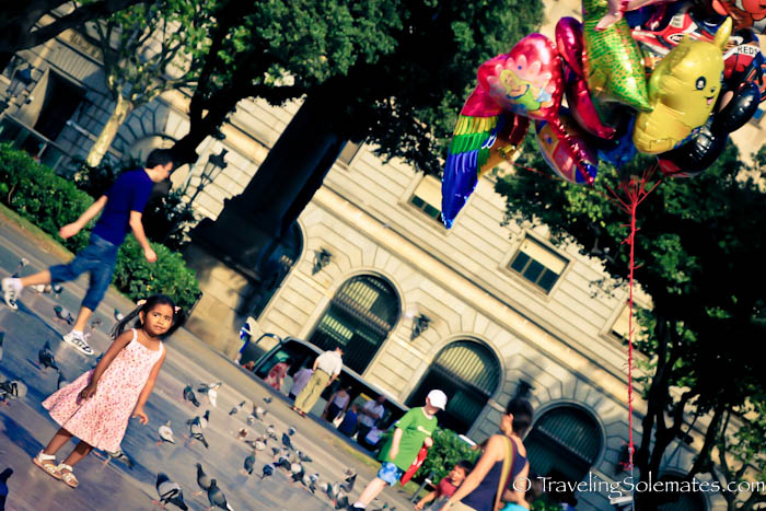 Little girl and balloons in Plaza Catalunya, Barcelona, Spain