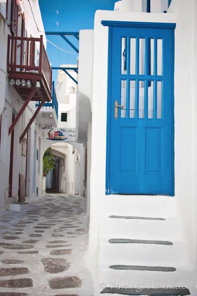 Blue Door in an Alley of Mykonos, Greece