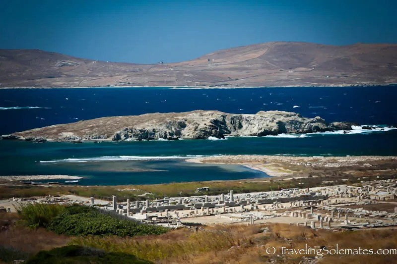 View of the ruins and surrounding island from a hill in Delos, Greece.