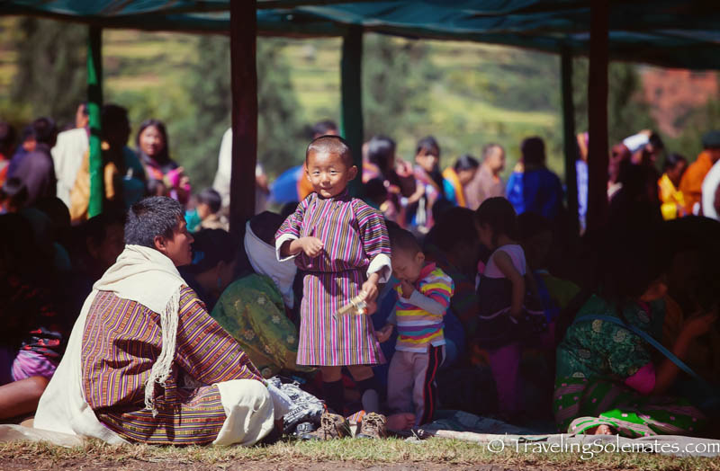 A boy in the crowd at Tsechue Festival in Wangdue, Bhutan