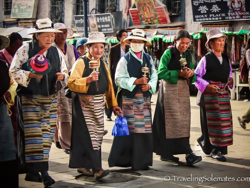 Women spinning handheld prayers wheels in Lhasa, Tibet