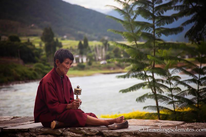 Woman with prayer wheel, Punakha Dzong, Bhutan