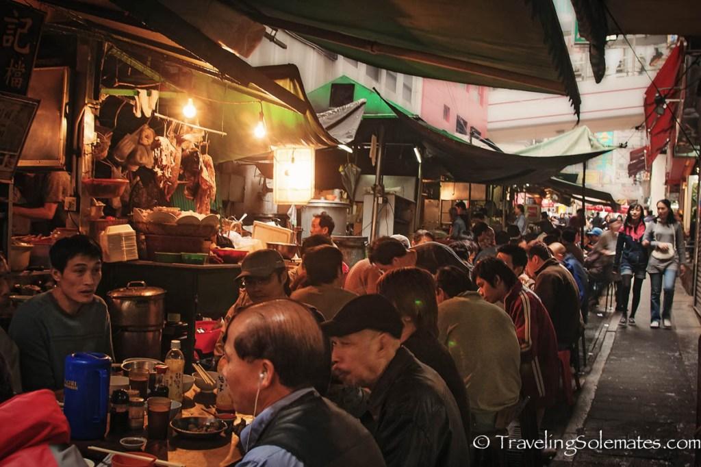 Men eating in food stalls in Sheung Wan, Old Hong Kong